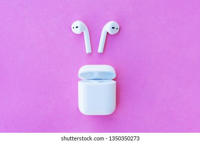 ROSTOV-ON-DON, RUSSIA - APRIL 28, 2018: Apple AirPods wireless Bluetooth headphones and charging case for  Apple iPhone. New Apple Earpods 2 Airpods in box.