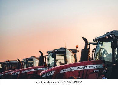 Rostov-on-Don, Russia - August 07 2019: Massey Ferguson tractors with logo. Massey Ferguson Limited is an American-owned major manufacturer of the agricultural equipment.
