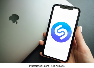 ROSTOV-ON-DON / RUSSIA - August 1 2019: Screen shot of Shazam app logo.  Womans hand holding iPhone X with music service Shazam on the screen.