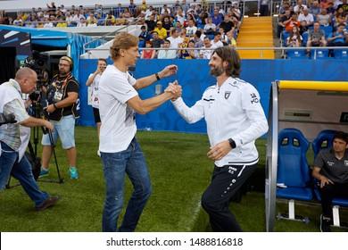 Rostov-on-Don, Russia - AUGUST 25, 2019: Valeri Karpin of FC Rostov greet Roman Sharonov of FC Rubin before the Russian Premier League match between FC Rostov and FC Rubin Kazan