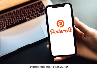 ROSTOV-ON-DON / RUSSIA - August 5 2019: hands holding the iPhone X with Pinterest app logo on the screen.