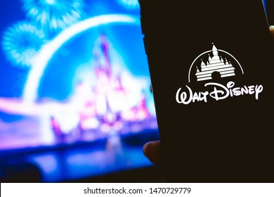 ROSTOV-ON-DON / RUSSIA - August 5 2019: hand holding the iPhone X with Disney logo on the screen. Disney background