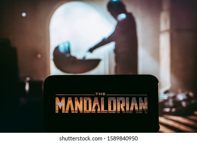 ROSTOV-ON-DON / RUSSIA - December 16 2019: Mandalorian from Star Wars  TV series Poster, the iPhone with shot of Madalorian Lucasfilm