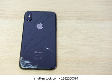 ROSTOV-ON-DON, RUSSIA - DECEMBER 20, 2018:  iPhone Ten X with broken display. Modern smartphone with damaged glass screen. Device needs repair.
