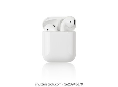Rostov-on-Don, Russia - December 2019. Apple AirPods on a white background. Wireless headphones in a charging case close-up.