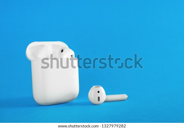 ROSTOV-ON-DON, RUSSIA - February 24, 2019: Apple AirPods wireless Bluetooth headphones and charging case for  Apple iPhone. New Apple Earpods Airpods in box.