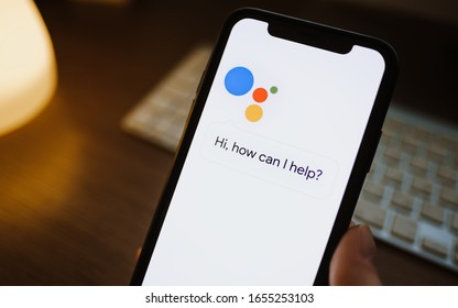ROSTOV-ON-DON / RUSSIA - February 25 2020 : woman use google assistant app on the iPhone
