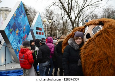 ROSTOV-ON-DON, RUSSIA - FEBRUARY 7:  Unidentified girl in an embrace with Olympic bear-start Olympic countdown clock time before the Olympic Winter Games 2014 in Sochi, February 7, 2013 in Rostov-on-Don, Russia