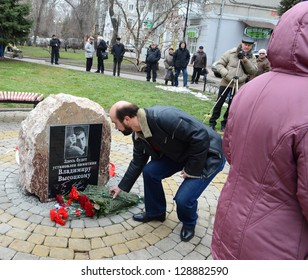 ROSTOV-ON-DON, RUSSIA -Â?Â? JANUARY 25: An unidentified man places flowers at the Opening ceremony the first stone of the monument to Vladimir Vysotsky, January 25, 2013 in Rostov-on-Don, Russia