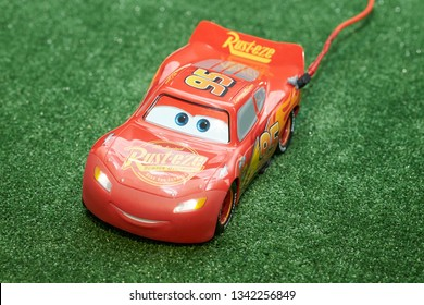 """Rostov-on-Don, RUSSIA - January 5, 2019. Red car from the cartoon """"Cars"""" on a green background at the exhibition """"Festival of Robots"""" in Rostov-on-Don."""