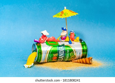 Rostov-on-Don, Russia - July 08, 2020: Funny plasticine men sunbathe lying on a can of beer. Dutch beer cen, Hollandia, Brewed in Holland, since 1758