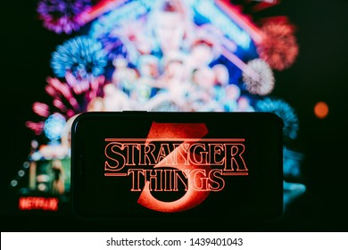 ROSTOV-ON-DON / RUSSIA - July 1 2019: Stranger Things 3 from Netflix TV series Poster, the iPhone with shot of Stranger Things Season 3