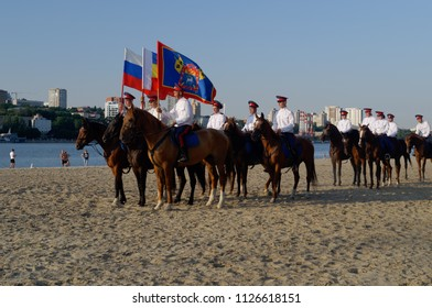 "Rostov-on-Don, Russia - July 2, 2018: Horse patrol on embankment near the football stadium ""Rostov Arena"" in the days of FIFA World Cup"