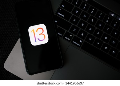 ROSTOV-ON-DON / RUSSIA - July 4 2019: iPhone and MacBook with iOS 13 logo on the screen, new operating system which will be released in the fall of 2019