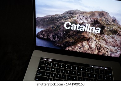 ROSTOV-ON-DON / RUSSIA - July 4 2019: MacBook with Mac OS Catalina background logo on the screen, new operating system which will be released in the fall of 2019