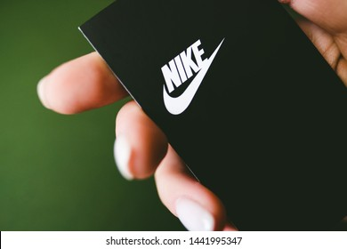 ROSTOV-ON-DON / RUSSIA - July 4 2019: Closeup of Nike logo label on green background. Nike logo. Nike is a global sports clothes