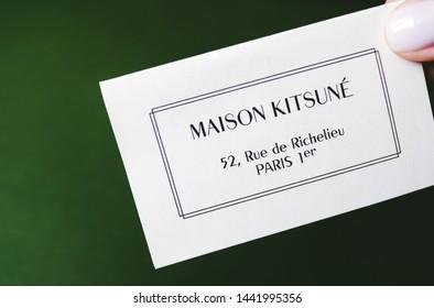 ROSTOV-ON-DON / RUSSIA - July 4 2019: Closeup of Maison Kitsune logo label on green background . Maison Kitsune is fashion clothing store