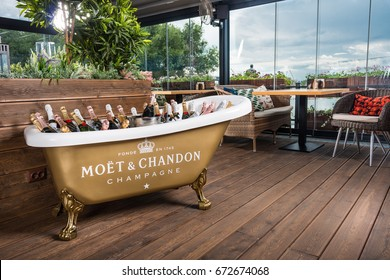 "ROSTOV-ON-DON, RUSSIA - JUNE 2017: The bath is filled with ice and champagne ""moet chandon"" in interior of restaurant. A splendid party. Higher Society."