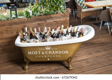 """ROSTOV-ON-DON, RUSSIA - JUNE 2017: The bath is filled with ice and champagne """"moet chandon"""" in interior of restaurant. A splendid party. Higher Society."""