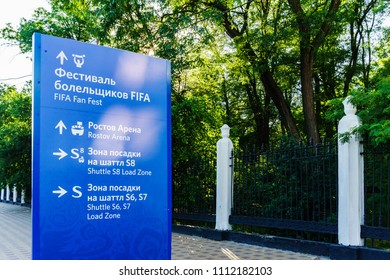 Rostov-on-Don / Russia - June 2018: The blue direction indicator for pedestrians tells where to go and written in two languages Russian and English