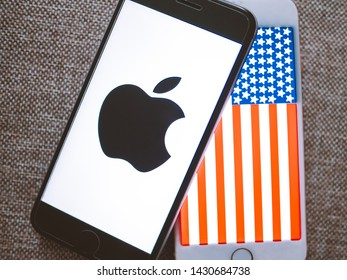 ROSTOV-ON-DON / RUSSIA - June 21 2019: Apple USA , apple logo and USA flag on screen iphone. Transfer of production of the iPhone in the USA.