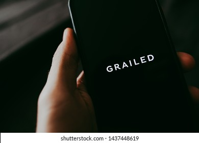 ROSTOV-ON-DON / RUSSIA - June 29 2019: Grailed online hype marketplace, hands holding smartphone with grailed app