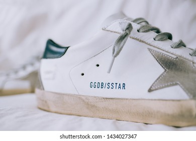 ROSTOV-ON-DON / RUSSIA - June 5 2019 : GGDB logo, Golden Goose Deluxe Brand Superstar Sneakers with Box
