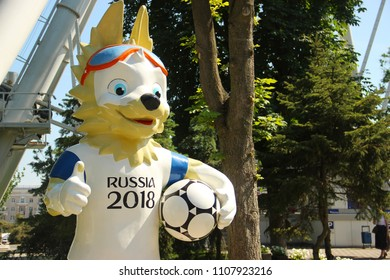 Rostov-on-Don, Russia - June 6 2018: The official mascot of the 2018 FIFA World Cup. Wolf Zabivaka character at the Theater Square in Rostov-on-Don. Ferris wheel on background. Preparing for mundial