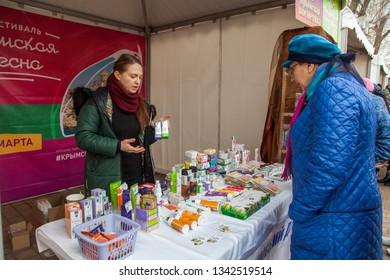 "Rostov-on-don, Russia, March 17 2019: City festival ""Crimean spring"". Five years Anniversary of Crimea's Reunification With Russia. Fair of the Crimean goods. Crimean cosmetics seller"