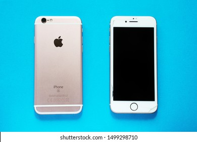 ROSTOV-ON-DON, RUSSIA - March 17, 2019: lithium ion black battery from Apple iPhone 6 and smartphone Apple iPhone 8 and Apple iPhone 6 on a blue background.