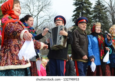 ROSTOV-ON-DON, RUSSIA - MARCH 17: Cossack dancing and singing. The Cossack Maslenitsa - traditional celebration and national ski races around, March 17, 2013 in Rostov-on-Don, Russia