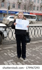 ROSTOV-ON-DON, RUSSIA - MARCH 2: NO WAR! Picket in the city center, an elderly woman with a placard, March 2 2014 in Rostov-on-Don, Russia