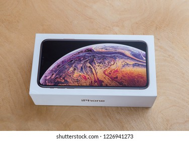 Rostov-on-Don, Russia - November 2018. Apple iPhone XS Max 6.5-inch display in a box on a wooden surface. The box with the smartphone iPhone XS Max gold color on a wooden table.