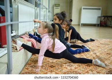 ROSTOV-ON-DON, Russia - November 24, 2017, training in children's rhythmic gymnastics group, - girls doing stretching