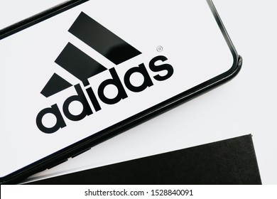 ROSTOV-ON-DON / RUSSIA - October 12 2019:  iPhone with Adidas logo on the screen. Black and white background