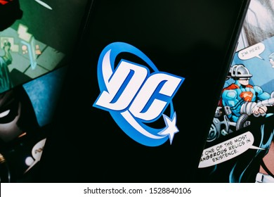 ROSTOV-ON-DON / RUSSIA - October 12 2019: iPhone with DC comics logo on the screen. comics page background.