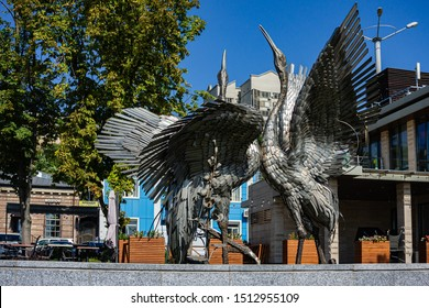 Rostov-on-Don, Russia - September 12, 2019: Close-up of metal statue. Two cranes, two dancing birds frozen in metal on embankment of Rostov-on-Don.