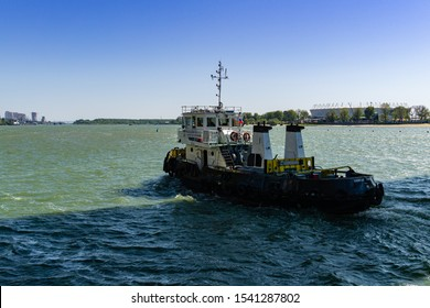 Rostov-on-Don, Russia – September 12, 2019: Tugboat Captain Kravtsov goes on Don river under Voroshilovsky bridge