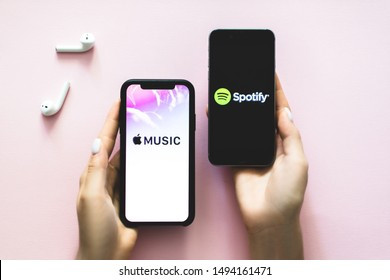 ROSTOV-ON-DON / RUSSIA - September 2 2019: hands holding iPhone X with Screen shot of Apple music app and Spotify. Apple Music and Spotify the most popular music streaming services