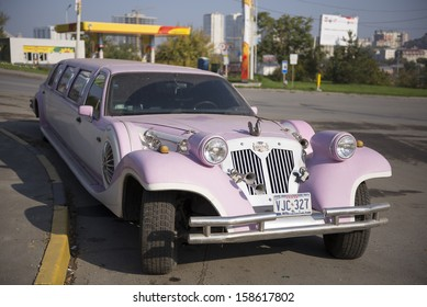 ROSTOV-ON-DON, RUSSIA-OCTOBER 13 - Executive Limousine pink in Rostov-on-Don in October 13, 2013 in Rostov-on-Don