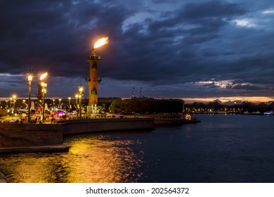 Rostral columns lit by illumination of the white nights at dawn, St. Petersburg, Russia