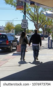ROSWELL, NEW MEXICO - OCTOBER 06: Couple Walking Holding Hands on Main Street in Roswell 2013