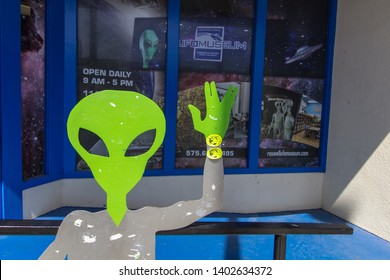 Roswell, New Mexico, USA - April 28, 2019: A little green extraterrestrial alien greets visitors to downtown Roswell, New Mexico. The small desert town became famous after an alleged UFO crash.