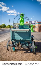 Roswell, NM, USA - April 21, 2018: A life size green UFO model just outside the town