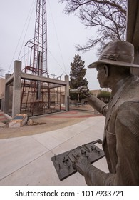 Roswell, NM/USA - March 3rd 2014: The statue of Robert Goddard over looks his rocket in its test stand.