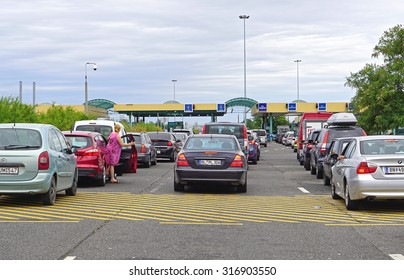 ROSZKE, HUNGARY - JULY 09, 2015: Long lines at border crossing in Roszke, Hungary. Traffic jam at customs checkpoint between Serbia and Hungary.