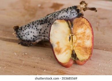 Rot and withered Fruits,On wooden plate