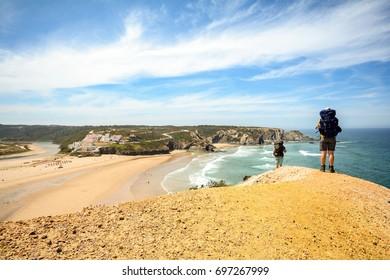 Rota Costa Vicentina hiking trail at the cliffs near beach Praia de Odeceixe, Algarve Portugal