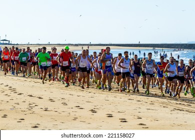 ROTA, SPAIN - AUG 10: Unidentified runners on the beach during XXV Athletic traverse Rota's beaches on August 10 , 2014, in Rota , Spain