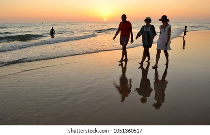 Rota, Spain - July 28, 2011: People walking on Costa Ballena beach at sunset, one the best beaches in Cadiz province bathed by Atlantic Ocean, Andalusia, Spain, southern Europe